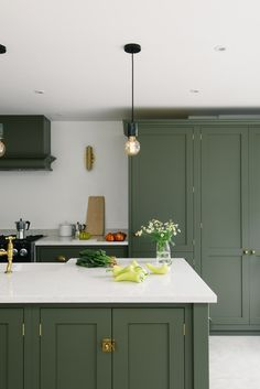 The Best in Dark Green Kitchen Trends - Town & Country Living - - According to several well-known home decor publications, shades of green are trending in the kitchen. Here are the best ideas in dark green kitchen trends. Kitchen Inspirations, New Kitchen, Dark Green Kitchen, Kitchen Interior, Kitchen, Devol Kitchens, Kitchen Trends, Kitchen Remodel, Country Kitchen