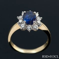 Traditional sapphire and diamond cluster ring in 18ct yellow gold. Comprising of a single, oval cut sapphire (.80ct approx) claw set and surrounded by 10 x round cut diamonds. The tapered shank draws the eye to the stones in this timeless design. £1800