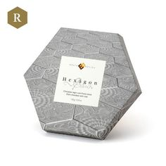 Chocolate Hexagon by Enric Rovira. Hexagon: 70% cocoa, almonds, hazelnuts, raisins and pine nuts, pure chocolate in all its splendor combining the flavors and textures of nuts.