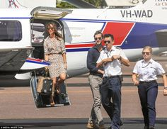 Pippa about to step off the plane to join James and the pilots already on the tarmac...