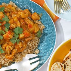 Chicken Korma | This classic Indian dish is so simple and bursting with flavor. This spicy crock pot recipe is perfect for any weeknight dinner. Leftovers are definitely the best next-day lunch. If you prefer milder foods, reduce or omit the crushed red pepper. Throw in some coconut, cashews, or mushrooms for an even more unique flavor. Add a quick and easy basket of warm garlicky naan on the side of this beloved chicken recipe.