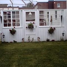 hubby and I made this fence out of old windows and a door , I love it!! Keep it the same color and it might just work.