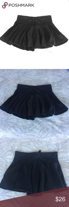 Juicy Couture black miniskirt Cute flair mini, can be worn casual or to the pool. Drawstring with raw edges. 100% cotton. Juicy Couture Skirts