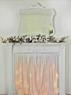 Use twinkle lights and fabric to create a dreamy mock fireplace.
