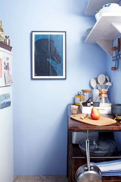 These Before & After Photos Have Us Wanting To Do A Reno-Free Room Makeover #refinery29 http://www.refinery29.com/one-kings-lane/12#slide-3 Walls: AfterAfter the skim coat and a layer of Benjamin Moore Blue Ice 821, the walls were gallery-worthy. They even inspired me to move a favorite print from the living room to the kitchen.Related: Paint A Door In Your House & Feel Like You've Been Transported