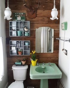 So it's snowing again. ...but these pretty little daffodils make it seem like spring *really* is on its wayand also...#tbt to the time we gutted this little bathroom and replaced the vanity with this mint green vintage pedestal sink, reclaimed barn wood shiplap and added some galvanized cubbies. The milk glass hanging lights are original to the house.
