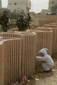 GAZA: A child in bunny costume and Israeli Defense Forces (IDF) Soldiers.