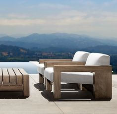 RH's Bardenas Lounge Chair:The vast, minimalist beauty of the desert landscape provided the inspiration for this collection designed by Leo Marmol and Ron Radziner. Crafted from premium teak, the low-slung, linear profile and squared-off form features deep seats and generously padded cushions.
