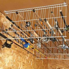 Clever Storage Ideas for Hard-to-Store Stuff Wire shelving into rack for fishing poles! (from 18 life-changing storage ideas)Wire shelving into rack for fishing poles! (from 18 life-changing storage ideas) Fishing Pole Storage, Fishing Pole Holder, Pole Holders, Fishing Poles, Ice Fishing, Bass Fishing, Crappie Fishing, Fishing Box, Fishing Bobbers