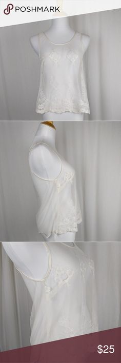 "Sheer Ivory Lace & Satin Festival Swing Tank Top Sheer Summer Lace Festival Tank. Size Small. By American Eagle. Sheer mesh with embroidered lace and Satin trim. Perfect with denim cutoffs and a sexy bra or tank. Snaps to hold bra straps in place. Loose or swing fit. Very soft and stretchy. Excellent condition.  Ivory or cream color. Length- 22"" Bust- up to 38"" Waist- up to 44"" American Eagle Outfitters Tops Tank Tops"