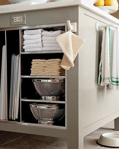 Kitchen Organization.  Half sheets vertically and stainless lined.