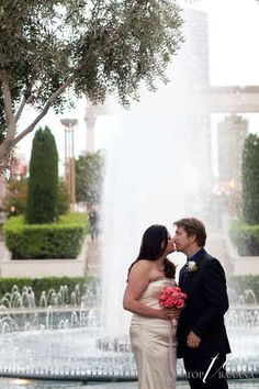 My favorite location for elopements...Caesar's water fountain with lush landscaping. #elopetovegas