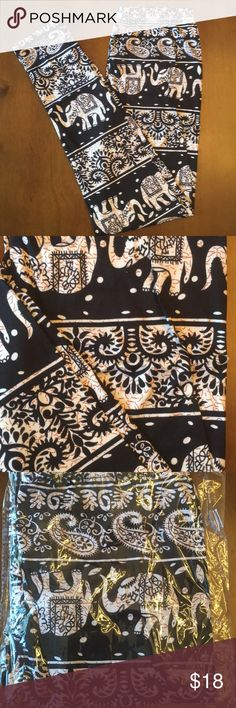NWT Elephant Print Leggings Buttery soft Leggings NWT in packaging!!   Inseam: 23 Inches  90% Polyester  10% Spandex  One Size Pants Leggings