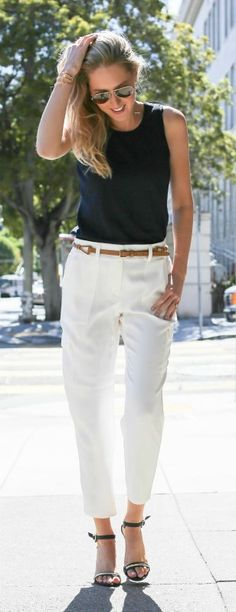 navy crewneck knit sleeveless top shell, skinny cognac brown belt with gold hardware, ivory off white crepe cropped dressy cargo pants, navy ankle strap heeled sandals with gold bar across toes {Ann Taylor | @AnnTaylorStyle)