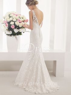 Alluring and elegant, floral lace mermaid wedding dress. Sleeveless bodice with V-neckline, mermaid skirt with scalloped hemline. Open v back is hand cut from floral lace, button detailing, sweep train. Wedding Dresses Nz, Wedding Dress Train, Lace Mermaid Wedding Dress, Mermaid Skirt, Elegant Wedding Dress, Cheap Wedding Dress, Bridal Dresses, Bridesmaid Dresses, Floral Lace