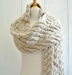 KNITTING PATTERN for a striking, super cozy wrap. Beautiful, intricate pattern - looks complicated but is manageable for a practiced beginner used to basic knitting abbreviations and  simple cabling! Find this pattern at LoveKnitting.Com!