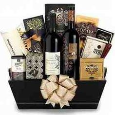 "A perfect balance of food and wine, this upscale gift basket first impresses with the prestigious selection of two acclaimed red wines: Maryhill Winemaker's Blend and Terra D'Oro Amador Zinfandel,16"" x 13"" x 9"""