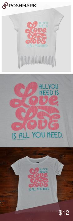 "New BEATLES All You Need Is Love Short Sleeve Tee Keep your girl sharing a positive message — and showing off her cool taste in music — with The Beatles All You Need is Love Short-Sleeve T-Shirt from Lyrics by Lennon & McCartney. This white graphic tee brings vintage vibes w/the fringed hem & washed-out ""All You Need is Love, Love is All You Need"" graphic. Whether she pairs this with bell-bottom jeans for a '70s day out or with a denim skirt when she's heading back to school, she'll never…"