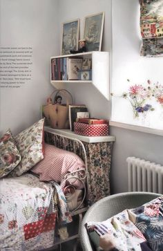 storage space created behind the bed / Perfect English Cottage (2009) by Ros Byam Shaw
