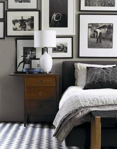 Black and white pictures above bed. i.e. Braves, Bulldog, Hawks, Falcons pictures