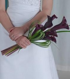 Contemporary Bridal Bouquet with Purple calla Lilies.