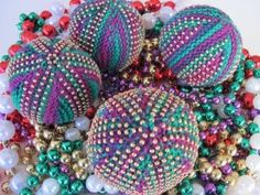 Mardi Gras! Beads are symbolic of this New Orleans Event, and now, you can knit your own, and you can bead your beads!  Yeah! Beaded Beads. How about that.