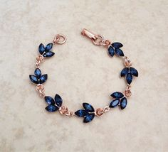Pretty bracelet done with gorgeous Swarovski navy blue crystals in rose gold plated metal. The rose gold sets off the navy blue crystals so beautifully! The bracelet is adjustable between 6 and 8 inches long. Stylish Jewelry, Cute Jewelry, Fashion Jewelry, Girls Jewelry, Jewelry Accessories, Jewelry Design, Wedding Bracelet, Wedding Jewelry, Magical Jewelry