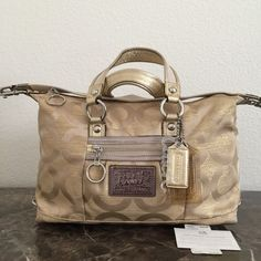 Authentic Coach Poppy Gold 2in1 Style Satchel bag Coach Poppy Goldmine Satchel / Shoulder bag.Preowned & very good condition.No stains,no rips.I store all my bags in dust bags.Color:Gold & Brown interior.✅Offers with blue Offer button Coach Bags Satchels