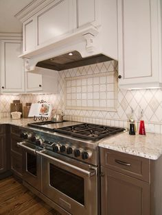 Two-tone tile creates an attractive backsplash behind a chef-grade range. Beaded face frame cabinetry has a classic look, while painting the upper and low cabinets a different color adds dimension to the kitchen.