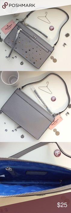 "💎New Item💎 Juicy Couture Clutch Cute little gray wristlet with gold, silver and pewter studs by Juicy Coutour. Small zip slot on the front and one small zip pocket inside. Measures 9""x5""X1"" with 9"" handle drop. Juicy Couture Bags Clutches & Wristlets"