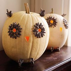 Whooo could resist such a cool pumpkin creation?  To make these wide-eyed owls, begin like you would for a classic jack-o'-lantern -- simply carve out the beak and eye holes. Then, use hot-glue to affix sunflower seeds around the eyes, ears and feet (both constructed with craft sticks).