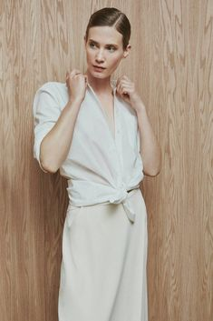 This simplified formula for warm-weather dressing is grounded in light-colored neutrals, from the optic white of a crisp button-up to a fluidly draping pareo in creamy hues, and made cool by natural fabrics such as cotton, linen, silk, and finely woven merino wool.