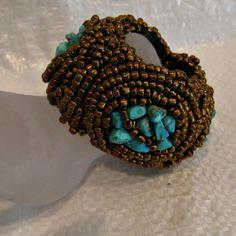 DBANE SEED  04 turquoise bits ,glass seed beads sewn onto crocheted raffia base ZAR 495