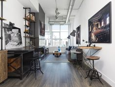 Fed up with all the beige walls and orange-hued wood, the owners of this small loft located in Toronto decided it was time for a change so they asked Rad D