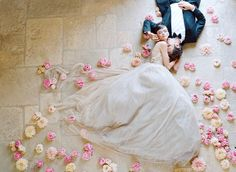 Stunning photo! A beautiful couple embracing surrounded by dahlias, peonies and roses in pink and peach hues!