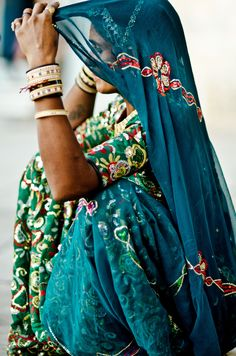 That embroidered blouse and skirt in green with blue.... Perfect for fruit seller