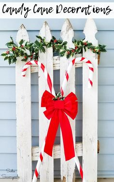 Wooden walking canes are simply PERFECT for upcycling into candy cane decorations to use on your front porch this Christmas season! And it's so easy to make with this repurposing idea from Sadie Seasongoods. #candycane #christmasdecordiy #diychristmasdecorations #xmasdecorations #christmasporch #frontporchdecor #christmasdecorationsdiy #diyholiday #diychristmasdecor #walkingcanes #upcycledcrafts #repurposing #christmascraftsdiy