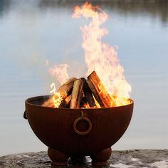 "Nepal Fire Pit this is a goot one 40"" wide, 24"" high can be put on deck, has a screen cover"