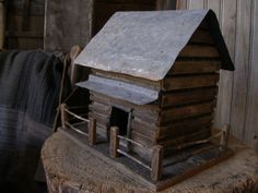 Sweet Liberty Homestead primitive log cabin birdhouse with hand whittled and pegged fence.