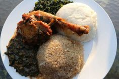 Traditional Zimbabwean food. Rice with peanut butter, sadza (cornmeal) and chicken.