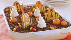 Ghosts in the Graveyard: 2pkg.  (3.9 oz. each) JELL-O Chocolate Instant Pudding  3cups  cold milk  1tub  (12 oz.) COOL WHIP Whipped Topping, thawed, divided  15  OREO Cookies, crushed (about 1-1/2 cups)   Assorted decorations: 3 CAMEO Creme Sandwich Cookies, decorating gel, 5 candy pumpkins, 10 candy corn pieces
