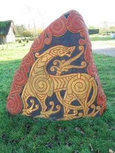 Norse carvings as they would have looked then.