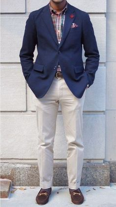 Shop this look on Lookastic: https://lookastic.com/men/looks/blazer-long-sleeve-shirt-dress-pants-loafers-pocket-square/245 — Navy Blazer — Beige Dress Pants — Brown Loafers — Plaid Long Sleeve Shirt — Plaid Pocket Square