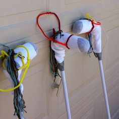 My girls made these at horse camp.. So easy and cute.  Cheap $store mop( leave plastic on), long sock(with the grey heels and toes), 5 pipe cleaners, yarn, google eyes, duct tape and hot glue!!  Cute for any horse themed party/curriculum!