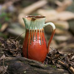 This is our Handmade Ceramic Pitcher in the Rustic Red outside in nature.  This decorative pitcher can be used as a water jug, tea pitcher, juice carafe, etc.It also looks great as a flower vase, and as a table centerpiece that adds style and elegance to any home decor!It makes a wonderful new home gift for newlyweds and can be given for Mother's day, Christmas or any other special occasion.  By Blanket Creek Pottery  #pitcher #hostessgift #serveware #handmadepottery Tea Pitcher, Ceramic Pitcher, Ceramic Tableware, Kitchenware, Handmade Ceramic, Handmade Home, Handmade Pottery, House Gifts, New Home Gifts