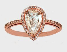 Delicate petite pave halo setting with pear cut center diamond and rose gold band | Halo engagement rings -- repinned by bridesandrings