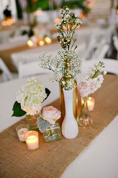 Small bunches of flowers in mismatched vases. Top 10 Floral Ideas to Make Your Wedding Bloom