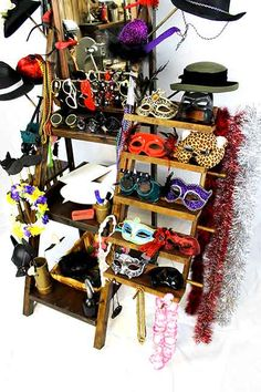 This is the prop rack that comes with the Victorian Steampunk photo booth rental. This is what we actually bring. Compare our props to the little box of plastic toys most other photo booth companies supply.