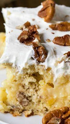 Hummingbird Poke Cake ~ flavored with banana, pineapple, and pecans. Topped with a creamy and sweet cream cheese frosting