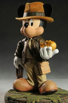 Mickey Mouse as Indiana Jones statue by Disney. This is my favorite Big Fig (galaxy cake dr. Henry Jones Jr, Harrison Ford Indiana Jones, Indiana Jones Films, Old Disney, Disney Fun, Disney Magic, Disney Movies, Mickey Mouse And Friends, Disney Mickey Mouse